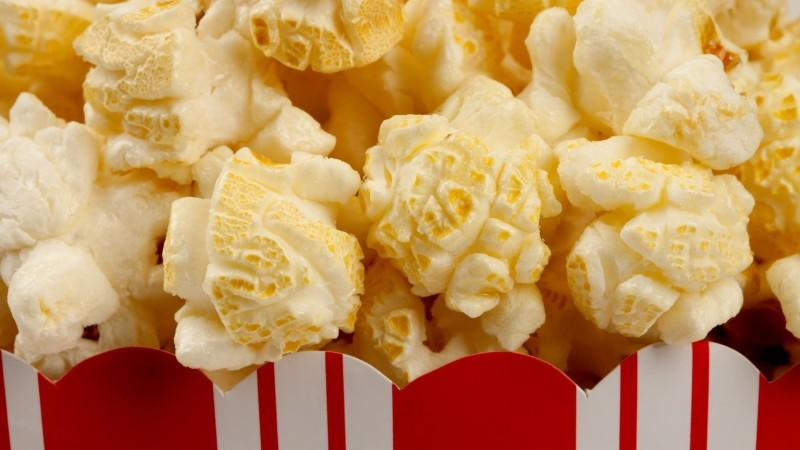 close up image of popcorn with overlay text that says laugh