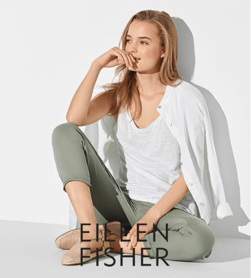 Eillen Fisher model is white shirt and green pants