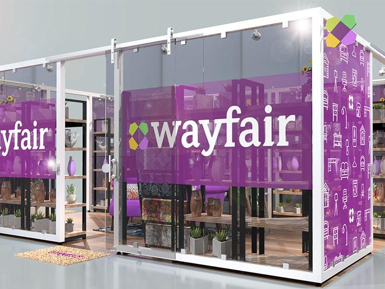 White box with Wayfair Branding and top to bottom windows showing off Wayfair products