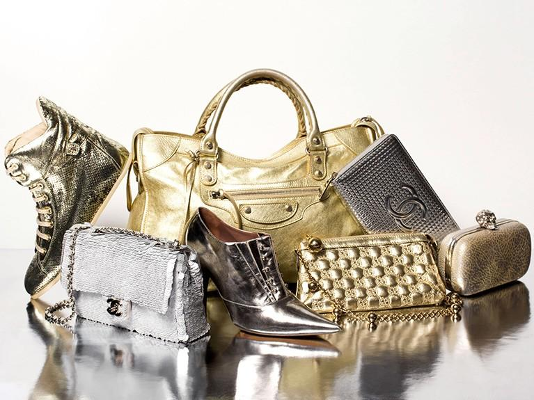Collection of gold and silver shoes and handbags