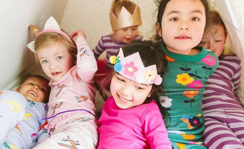 six children in pajamas playing around
