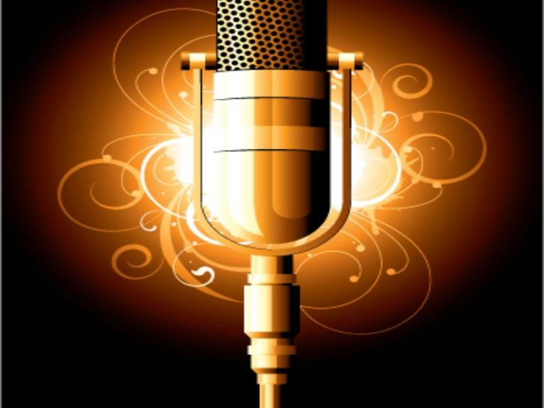 Picture of old style microphone with graphic elements in background
