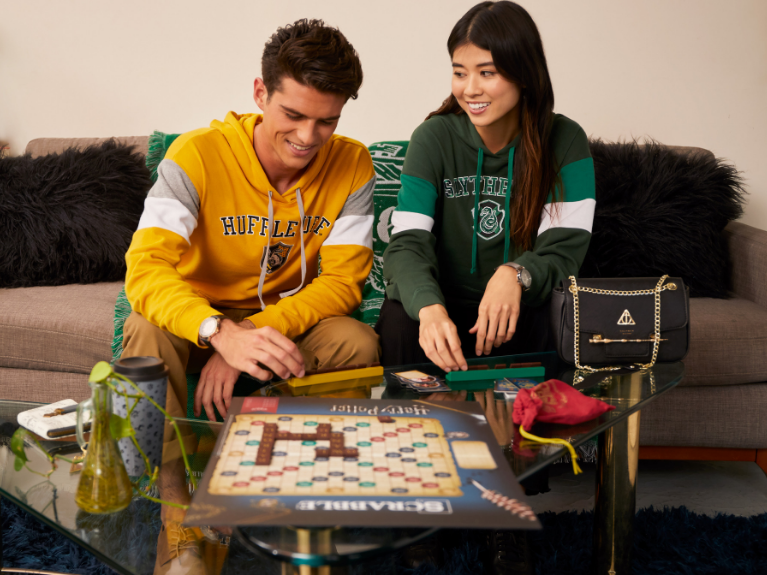 Two teens playing a board game