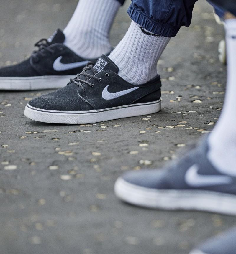 grey nike tennis shoes with a white swoosh