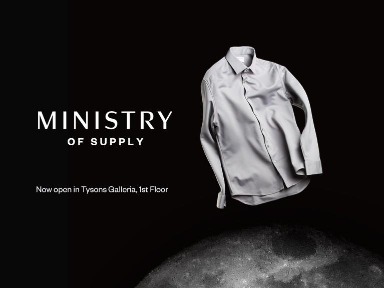 Grey button-up t-shirt floating on a black background with the Ministry of Supply logo.