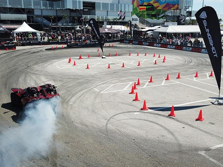 Drag racing course showcasing black and red slingshot car.