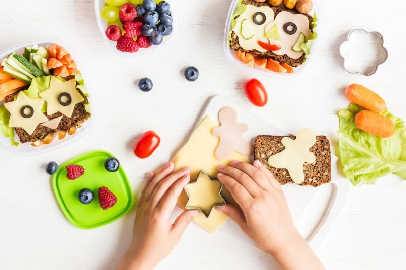 Cut up fruit and sandwhiches