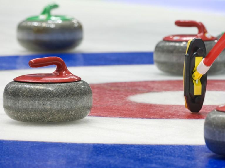 Curling sports pucks on ice