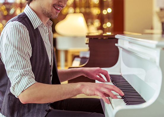 picture of a man playing piano